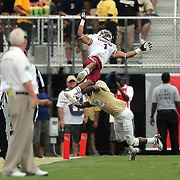 South Carolina Gamecocks wide receiver Damiere Byrd (1) gets upended by UCF Knights defensive back Jacoby Glenn (12) during an NCAA football game between the South Carolina Gamecocks and the Central Florida Knights at Bright House Networks Stadium on Saturday, September 28, 2013 in Orlando, Florida. (AP Photo/Alex Menendez)