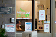 A staff member of the Menarock Life Essendon Aged Care Facility is seen wearing a facemask incorrectly as 31 people test positive to coronavirus in the home during COVID-19. After another horror 24 hours of 270 COVID-19 cases, bringing Victoria's active cases to over 1800, speculation is rising that almost all of Victoria's current cases stem from the Andrews Government botched hotel quarantine scheme.  Victoria is losing control of clusters as they start spreading through nursing homes, where our most vulnerable live. (Photo be Dave Hewison/ Speed Media)