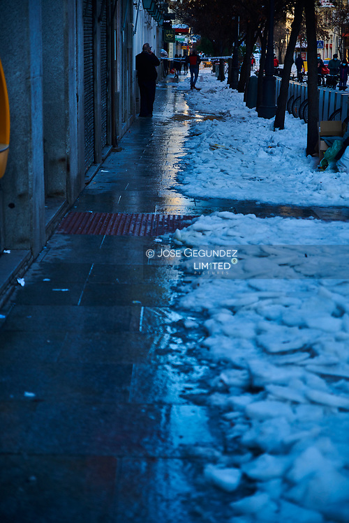 People walking for snowy Mayor Street on January 11, 2021 in Madrid, Spain.  Storm Filomena brought more than 50cm of snow to the Spanish capital, the most in decades.