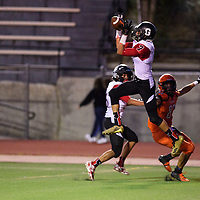 Michael Ramsey from Grants jumps for the interception in the end zone at the end of the second quarter against the Gallup Bengals at Angelo Dipaolo Memorial Stadium in Gallup, Friday, August 31, 2018.