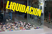 Window of a shop saying liquidation: closing down, a signifier of the precarious state of Argentina's economy, Buenos Aires, Argentina.