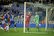 The ball sails over Doug Loft (Gillingham) on the line as Wigan win the game in dramatic style in injury time during the Sky Bet League 1 match between Wigan Athletic and Gillingham at the DW Stadium, Wigan, England on 7 January 2016. Photo by Mark P Doherty.