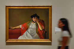 """© Licensed to London News Pictures. 27/06/2019. LONDON, UK.  A staff member walks by """"Gabrielle Vallotton"""", 1905, by Félix Vallotton. Preview of """"Félix Vallotton:  Painter of Disquiet"""", an exhibition of paintings and prints Swiss artist Félix Vallotton at the Royal Academy of Arts.  Around 100 works are on show 30 June to 29 September 2019.  Photo credit: Stephen Chung/LNP"""