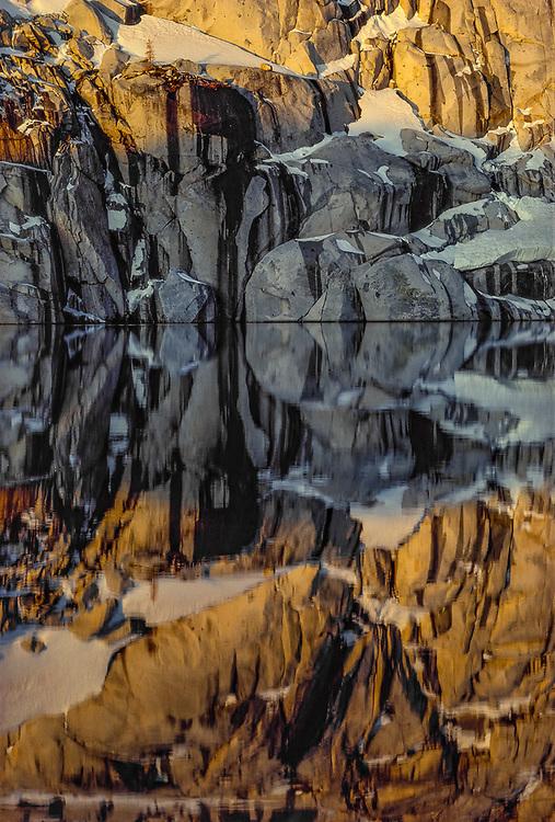 Morning reflection, granite boulders, autumn, Talisman Lake, Alpine Lakes Wilderness, Cascade Mountains, Washington, USA