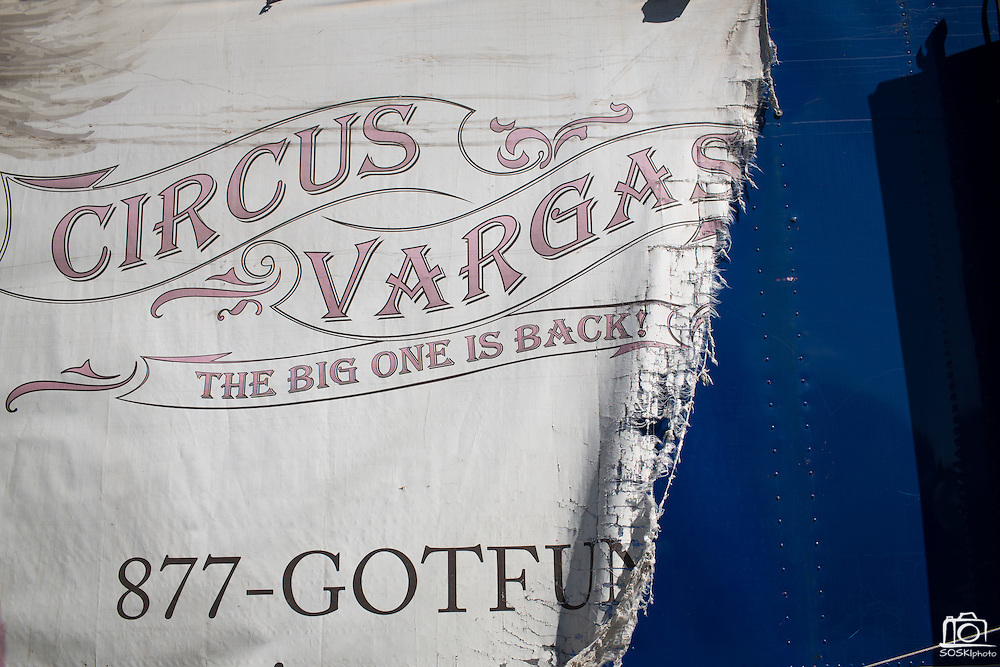 A weathered banner drapes over the side of a storage trailer while Circus Vargas pitches the big tent in preparation for a weekend of performances at the Great Mall of the Bay Area in Milpitas, California, on August 27, 2013. (Stan Olszewski/SOSKIphoto)
