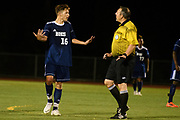 Burlington's Jake Manley (16) is reprimanded by the referee after taunting the other team after scoring a on a penalty kick during the boys soccer game between Stowe and Burlington at Buck Hard field on Wednesday night September 5, 2018 in Burlington. (BRIAN JENKINS/for the FRESS PRESS)