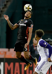 September 9, 2017 - Washington, DC, USA - 20170909 - D.C. United defender SEAN FRANKLIN (5) heads the ball over Orlando City FC forward GILES BARNES (14) in the first half at RFK Stadium in Washington. (Credit Image: © Chuck Myers via ZUMA Wire)