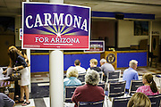 02 AUGUST 2012 - PHOENIX, AZ:  People wait for Dr. Richard Carmona to speak at an American Legion hall in Phoenix Thursday. Carmona, the former US Surgeon General under President George W. Bush, is running for the US Senate as a Democrat. Carmona's personal story is an important part of his campaign. He dropped out of high school to join the US Army. He applied for Special Forces and was turned down because he didn't have a high school diploma, he got his GED, reapplied and was accepted into Special Forces. He served in Vietnam as a combat medic. After he was discharged, he went back to college, became a R.N., went to medical school and became a surgeon, became a police officer and member of the SWAT Team in Tucson, AZ. He became the surgeon general in 2002 and returned to Tucson after his term as surgeon general.    PHOTO BY JACK KURTZ