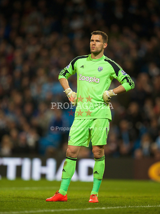 MANCHESTER, ENGLAND - Easter Monday, April 21, 2014: West Bromwich Albion's goalkeeper Ben Foster looks dejected as Manchester City score the second goal during the Premiership match at the City of Manchester Stadium. (Pic by David Rawcliffe/Propaganda)