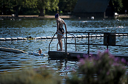 © Licensed to London News Pictures. 13/06/2021. London, UK. A woman prepares to take a dip in the early morning sunshine in Hyde Park central London on a hot summer's day. Temperatures in the capital are expected to reach a high for the year. Photo credit: Ben Cawthra/LNP