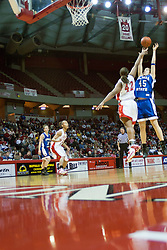 04 February 2006:  Lawhawn Johnson fould Laura Rudolphi under the hoop. The Indiana State Sycamores shook the Illinois State Redbirds from the nest with a 75-71 Victory.  There were 3,581 fans on hand, making the audience the  2nd largest women's basketball crowd ever in Redbird Arena on Illinois State University campus in Normal Illinois.