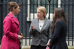 © London News Pictures. 18/05/15. London, UK. Plaid Cyrmu leader Leanne Wood chats with Green Party leader Natalie Bennett after they handed in a petition at 10 Downing Street calling for electoral reform, Westminster, Central London. Photo credit: Laura Lean/LNP/05/15.