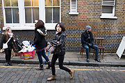 People in the streets surrounding Columbia Road flower market in the East End of London, UK. This is one of London's famous Sunday street markets which are all within a mile or so of each other.