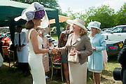 ISABEL KRISTENSEN; MRS. GEORGE PISKOVA, Lunch part hosted by Liz Brewer and Mrs. George Piskova in No; 1 car-park. . Royal Ascot. Tuesday. 14 June 2011. <br /> <br />  , -DO NOT ARCHIVE-© Copyright Photograph by Dafydd Jones. 248 Clapham Rd. London SW9 0PZ. Tel 0207 820 0771. www.dafjones.com.