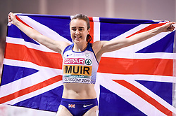 Great Britain's Laura Muir celebrates after winning the gold medal in the Women's 1500m final during day three of the European Indoor Athletics Championships at the Emirates Arena, Glasgow.