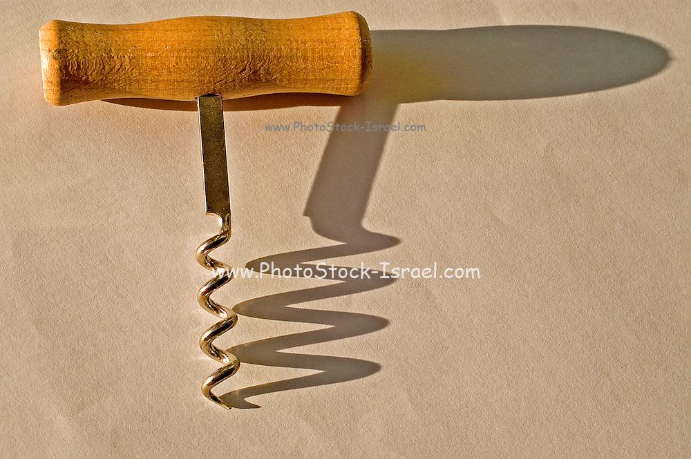wooden handle cork screw and shadow