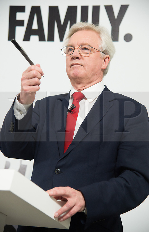 """© Licensed to London News Pictures. 03/05/2017. London, UK. DAVID DAVIES the Secretary of State for Exiting the European Union speak at a General Election Campaign event featuring a poster of Labour party leader JEREMY CORBYN with the slogan """"More debt, higher tax."""" Photo credit: Ray Tang/LNP"""