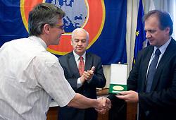Award Plaketa NZS for year 2009 of Slovenian football federation (NZS) for Janez Polajnar of MNZG Kranj (L) given by president of NZS Ivan Simic, on May 7, 2009, in Hotel Kokra, Brdo at Kranj, Slovenia.  (Photo by Vid Ponikvar / Sportida)