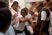 Cigar and dancing, ceremony at Terreiro (yard) peace and love / Terreiro Paz y Amor, Salvador, Bahia, Brazil. Often the lines between Candomble, Catholicism and Umbanda are blurred. Salvador de Bahia is seen as the home of Candomble.