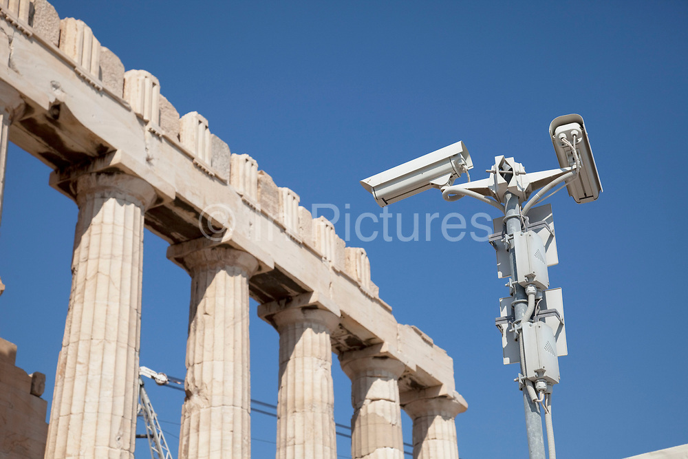 Security cameras at the Parthenon at Acropolis of Athens. The Parthenon and other main buildings on the Acropolis were built by Pericles in the fifth century BC as a monument to the cultural and political achievements of the inhabitants of Athens. The term acropolis means upper city and many of the city states of ancient Greece are built around an acropolis where the inhabitants can go as a place of refuge in times of invasion. It's for this reason that the most sacred buildings are usually on the acropolis. It's the safest most secure place in town. As little as 150 years ago there were still dwellings on the Acropolis of Athens. Athens is the capital and largest city of Greece. It dominates the Attica periphery and is one of the world's oldest cities, as its recorded history spans around 3,400 years. Classical Athens was a powerful city-state. A centre for the arts, learning and philosophy.