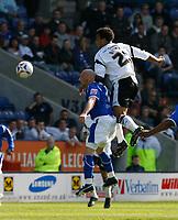 Photo: Steve Bond.<br />Leicester City v Derby County. Coca Cola Championship. 06/04/2007. Giles Barnes (L) rises above Iain Hume