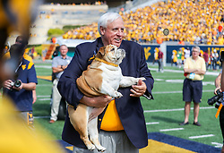 """Sep 18, 2021; Morgantown, West Virginia, USA; West Virginia Governor Jim Justice and his dog, """"Baby Dog"""" flip the coin to begin the game at Mountaineer Field at Milan Puskar Stadium. Mandatory Credit: Ben Queen-USA TODAY Sports"""
