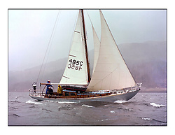 The Clyde Cruising Club's 1977 Tomatin Trophy the first Scottish Series held at Tarbert Loch Fyne.  An overnight race from Gourock to Campbeltown then on to Olympic Triangles in Loch Fyne. .485C St Anton owned by L Young arrives in the rain to Tarbert.