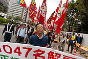 Yasahiro Tanaka, (centre) President of Doro Chiba railway Union, leads a march at The National Worker`s Rally organised by Marxist groups and Doro Chiba labour union in Tokyo, Japan, Sunday, November 1st 2009