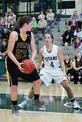 12 December 2015:  Allie Miceli controls the ball while defended by Rebekah Ehresman during an NCAA women's basketball game between the Wisconsin Stevens Point Pointers and the Illinois Wesleyan Titans in Shirk Center, Bloomington IL