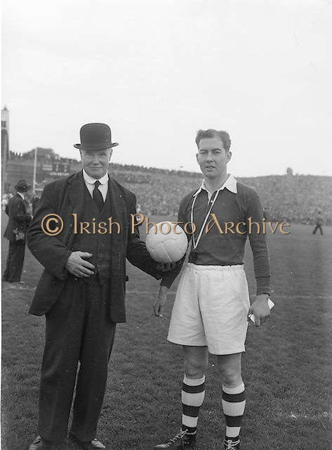 Referee receiving the game ball before the All Ireland Senior Gaelic Football Championship Final Louth v Cork at Croke Park on the 22nd September 1957. Louth 1-09 Cork 1-07.