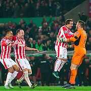 Stoke City players congratulate Jack Butland after he saves  Eden Hazard's penalty during a shootout to knock Chelsea out in the Capital One Cup in the fourth round match at the Britannia Stadium, Stoke-on-Trent. October 22, 2015.<br /> <br /> Picture by Jack Megaw/Focus Images Ltd +44 7481 764811<br /> 27/10/2015