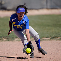 Zuni Thunderbird shortstop Kaitlin Romancito (1) scoops up a grounder from the Tohatchi Cougars Friday at Tohatchi High School.