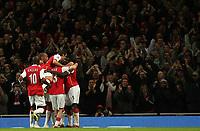Photo: Paul Thomas.<br />Arsenal v Liverpool. The Barclays Premiership. 12/11/2006.<br /><br />Kolo Toure (5) and Arsenal celebrate his goal.