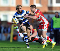 Nick Abendanon (Bath) is double-tackled by Mike Tindall and Henry Trinder (Gloucester) - Photo mandatory by-line: Patrick Khachfe/JMP - Tel: Mobile: 07966 386802 12/04/2014 - SPORT - RUGBY UNION - Kingsholm Stadium, Gloucester - Gloucester Rugby v Bath Rugby - Aviva Premiership.