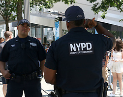 June 23, 2017 - New York, New York, U.S. - NYPD Counterterrorism unit patrol the National September 11 Memorial & Museum. Plans were announced to add a tribute to the Ground Zero Recovery and Rescue Workers. The tribute at the National September 11 Memorial and Museum is expected to be a ''commemorative space and walkway'' in the Memorial Glade, a grassy clearing in the southwest corner of the 8-acre (3.24-hectare) site that once held the Twin Towers. (Credit Image: © Nancy Kaszerman via ZUMA Wire)