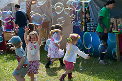© Licensed to London News Pictures. 29/05/2016. Hay-on-Wye, Powys, Wales, UK. Children enjoy bubbles by Dr Zigs. Beautiful weather on the fourth day of the 'HowTheLightGetsIn' Festival of Ideas at Hay-on-Wye, Wales. Photo credit: Graham M. Lawrence/LNP
