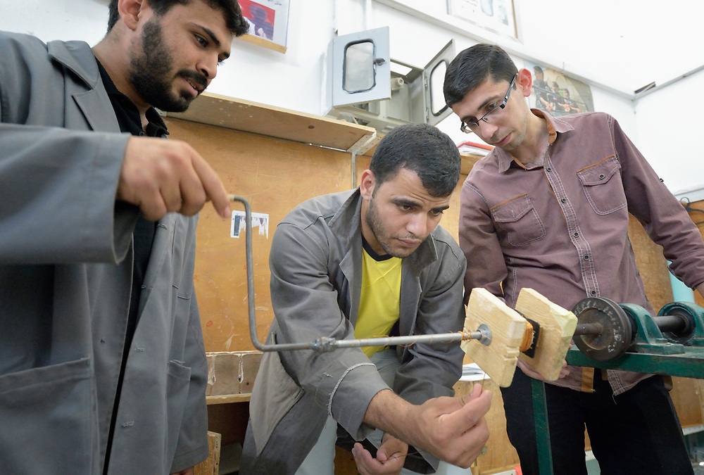 Teacher Mohammed Alatrush (right) instructs students in a class in electrical wiring at the Vocational Training Center in Khan Yunis, Gaza. The center is sponsored by the Department of Service for Palestinian Refugees of the Near East Council of Churches, and funded in part by the Pontifical Mission for Palestine. DSPR is a member of the ACT Alliance.