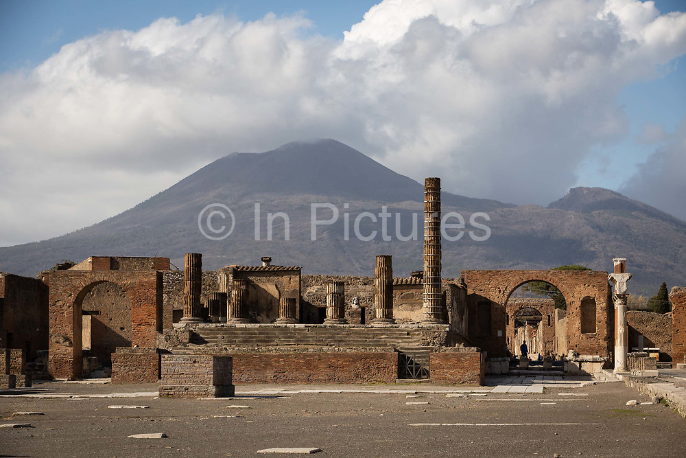 A man is silhouetted in an archway in the Forum at the Pompeii Archeological Park on Friday 6th March 2020 in Pompei, Italy. Park officials estimate that visitor numbers are down to a sixth of what they would normally be as a result of the spread of Coronavirus, which has prompted the closure of all Italian schools and universities, and the postponing of many sporting events. .