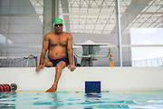 """2016/06/04 – Bogotá, Colombia: Moises Fuentes Garcia, 41, sits on the border of the swimming pool, before the beginning of his training session at the Simon Bolivar Aquatic Complex, Bogotá, 4th June, 2016.<br />  -<br /> Moises used to be a farmer and sell cattle with his brother when in October 1992, Paramilitaries in the region of Santa Marta targeted them. Moises was shot six times, and his brother killed. He was """"lucky"""" to survive, one of the bullets crossed his neck, and one stuck into his spine and he couldn't walk again. However it did not end there, a few months later, during a rehabilitation session he broke his leg and due to an infection he had to amputate it. Moises felt it wasn't worth living anymore. But after meeting a group of other victims that had even more severe injures, he grabbed life with will and began to feel motivated. He started playing wheelchair basketball and studying. In the process of the rehabilitation he was spotted as a good swimmer, even if he didn't possess any technique. After some success on the swimming pool, he became completely dedicated to the sport, while finishing degrees as a tailor, public accountant and hopes to graduate as a sport teacher next year. <br /> Among many achievements he won the Bronze medal in 2008 Paralympic Games in Beijing and Silver medal on the 2012 Paralympic Games in London on the 100 meters breaststroke category. He also became the World Champion at the 2013 World Swimming Championships. Moises hopes that in the Rio 2016 Paralympics, he will bring gold home. <br /> He believes that people must value their life, what they have and help people on the way. """"Everyone is a champion, but some people don't do the necessary to really became one"""" he says. (Eduardo Leal)"""