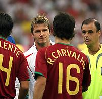 Photo: Chris Ratcliffe.<br /> England v Portugal. Quarter Finals, FIFA World Cup 2006. 01/07/2006.<br /> David Beckham of England shakes hands with Ricardo Carvalho of Portugal.