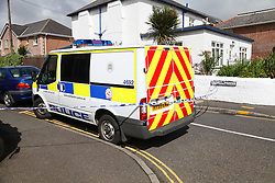 © Licensed to London News Pictures. 05/07/2014. Sandown, Isle of Wight, UK. Police tape cordoning off roads in Sandown on the Isle of Wight, where a body is believed to have been discovered on the pavement in the early hours this morning 5th July 2014. The body was discovered near the junction between Cross Street and North Street in the seaside town of Sandown. Scenes of Crime officers attended the scene early this morning, and the body was later removed in a private ambulance. Photo credit : Rob Arnold/LNP