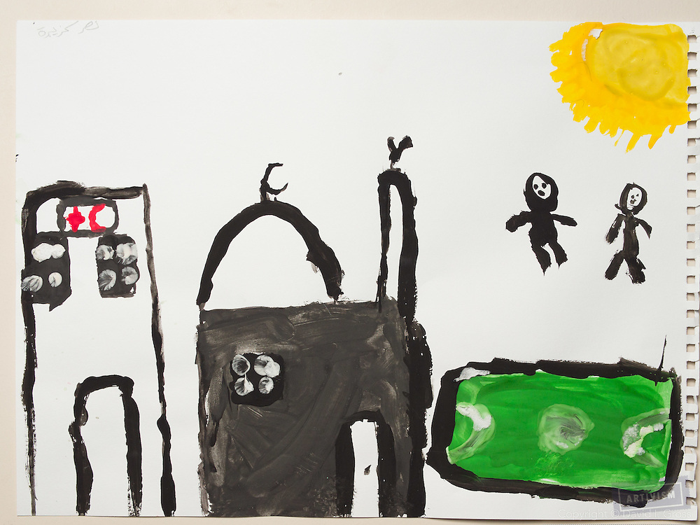 Before the war: a church (?) next to a mosque, next to a soccer pitch. Drawing by a 10 year old Syrian boy. (Topic for session: draw your impression of life before, during and after the war.)
