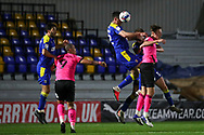 AFC Wimbledon defender Ben Heneghan (22) winning header during the EFL Sky Bet League 1 match between AFC Wimbledon and Peterborough United at Plough Lane, London, United Kingdom on 2 December 2020.