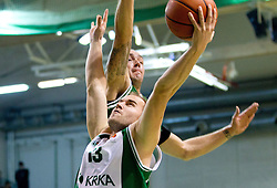 Bojan Krivec of Krka vs Damir Markota of Union Olimpija during basketball match between KK Krka and Union Olimpija Ljubljana of Round 7th of ABA League 2011/2012, on November 12, 2011 in Arena Leon Stukelj, Novo mesto, Slovenia. (Photo By Vid Ponikvar / Sportida.com)