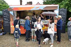 Thai street food at Redwell Brewery Art Car Boot Fair, annual festival showcasing local artists. Norwich June 2018