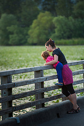 United States, Washington, Kirkland, mother and child on boardwalk at Juanita Bay Park
