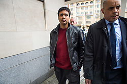 """© Licensed to London News Pictures. 23/03/2016. London, UK.""""Flash crash"""" Trader NAVINDER SINGH SARAO (centre) arrives at Westminster Magistrates court in London where Judgment in his extradition hearing is due to be given. Sarao, nicknamed the Hound of Hounslow, is accused of contributing to the 2010 flash crash. He has been charged with 22 counts of fraud and market manipulation by the US authorities who want to extradite him. Photo credit: Ben Cawthra/LNP"""