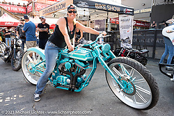 Kelly Mack, winner of the Sportster Class, on her 2001 Harley-Davidson Boardtrack Inspired custom in the  in the Dennis Kirk Garage Build bike show. Iron Horse Saloon during the Sturgis Motorcycle Rally. SD, USA. Tuesday, August 10, 2021. Photography ©2021 Michael Lichter.