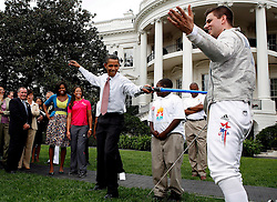 President Barack Obama fences playfully with Olympic Champion Tim Morehouse, during an event on Olympics, Paralympics and Youth Sport Canadian on the South Lawn of the White House, Washington, DC, USA on September 16, 2009. President Obama and his wife Michelle are supporters of  the candidacy of the city of Chicago as the city host for the Summer Olympic Games 2016. Photo by Aude Guerrucci/ABACAPRESS.COM (Pictured: Barack Obama, Michelle Obama, Tim Morehouse)  | 202082_009 Washington