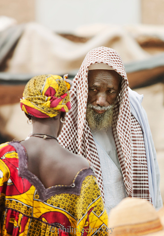 A man and woman talk at the weekly market in Djenné, Mali